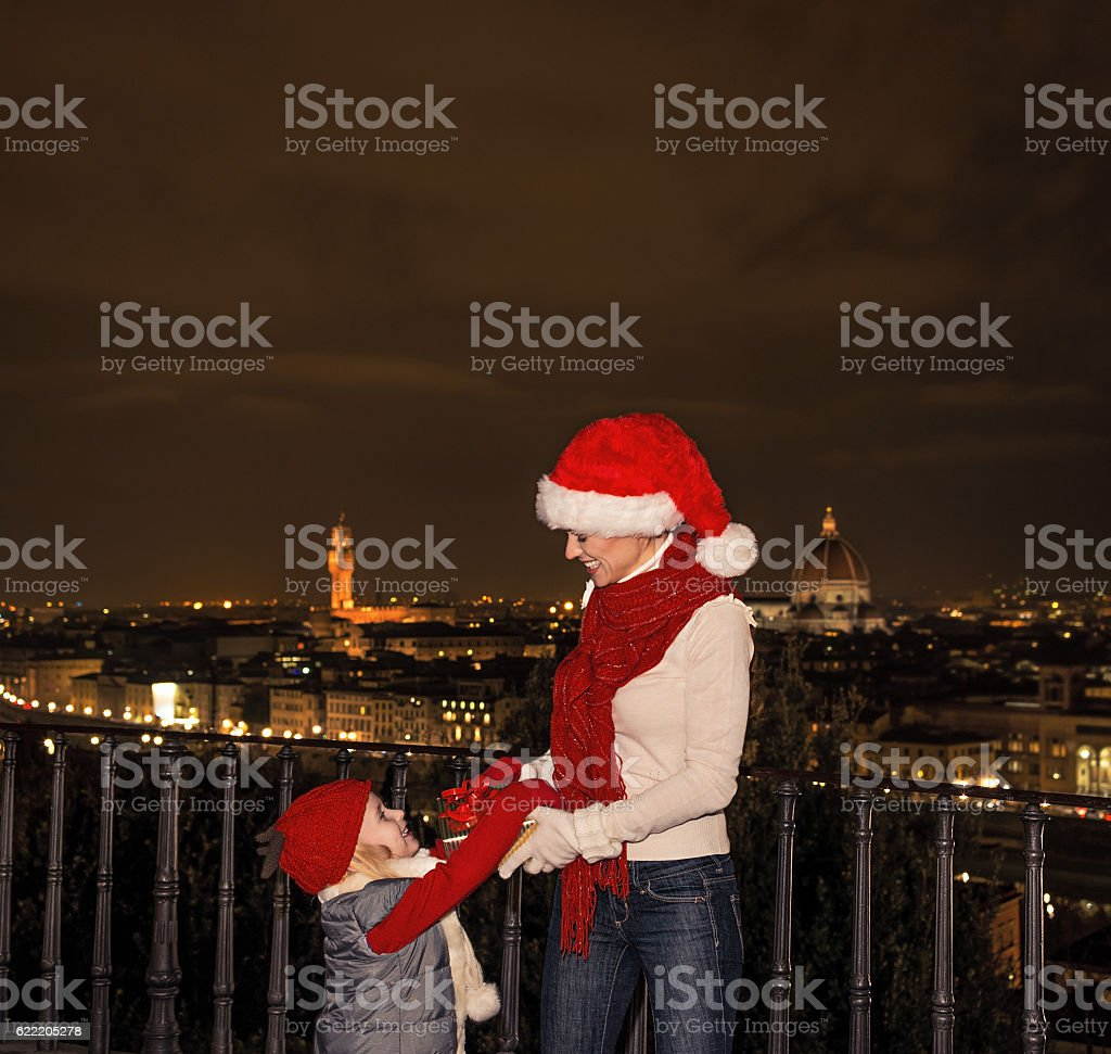 mother and daughter in Christmas hats, Florence playing stock photo
