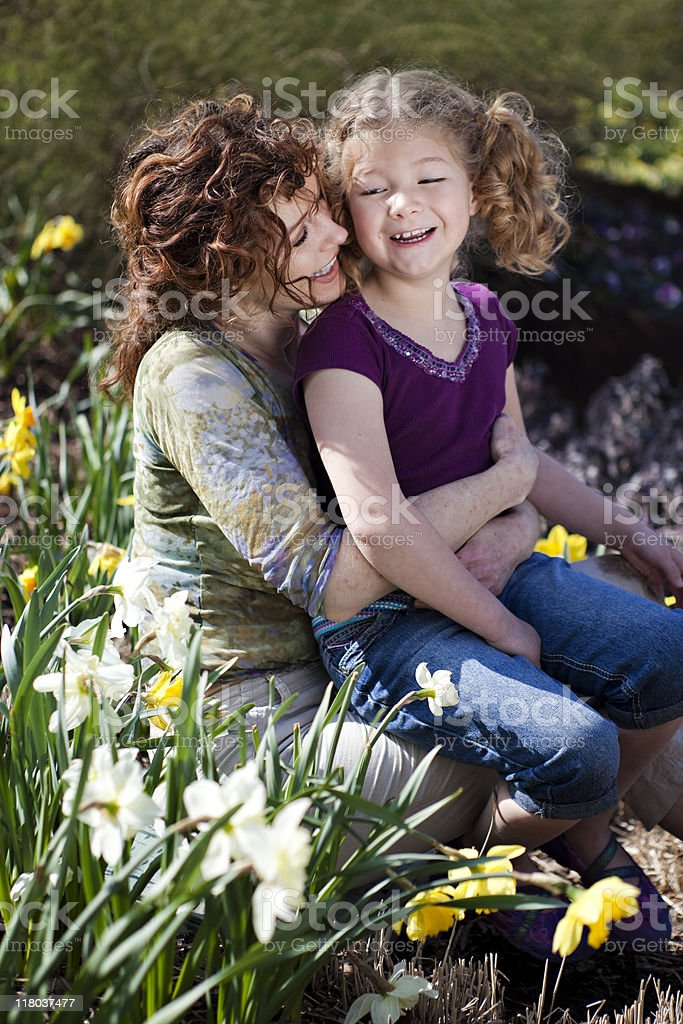 Mother and Daughter in Daffodil Flower Garden royalty-free stock photo