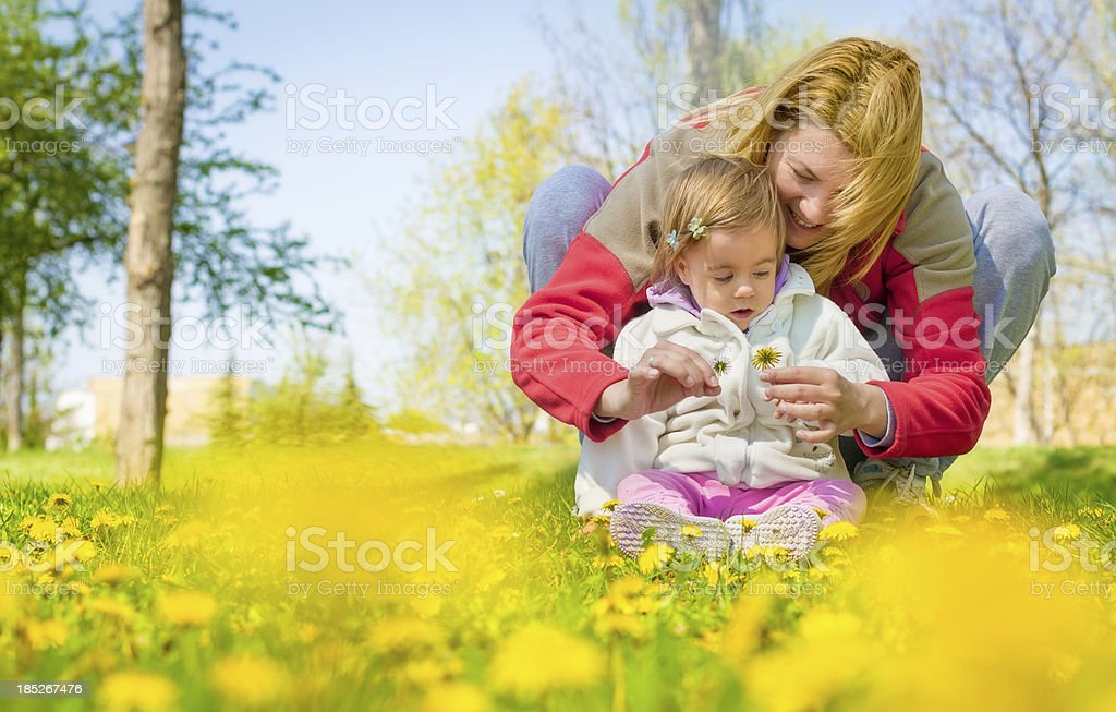 Mother and daughter in dandelion field royalty-free stock photo