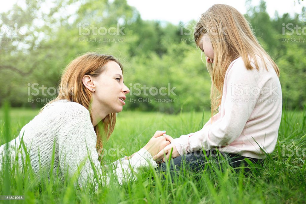 Mother and daughter in forest together stock photo