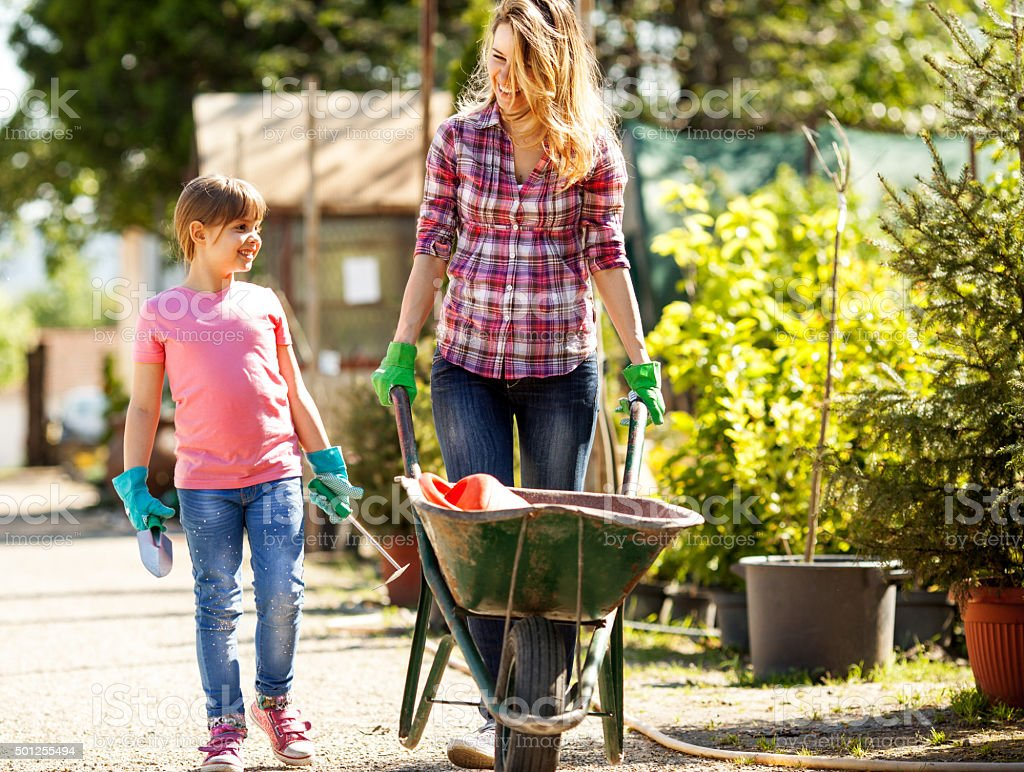 Mother and daughter in garden. stock photo