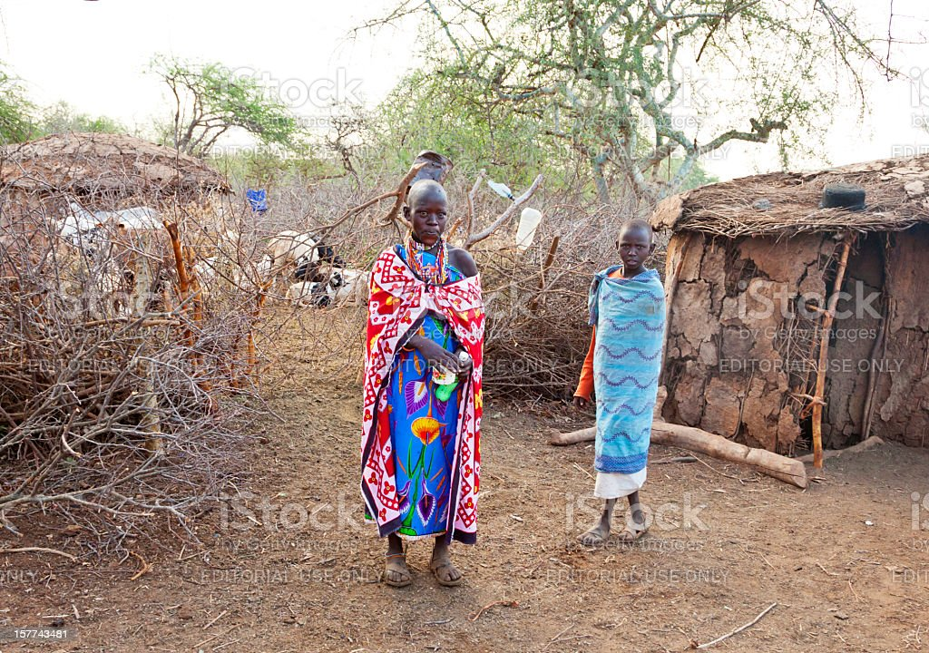 Mother and daughter in maasai village early morning stock photo