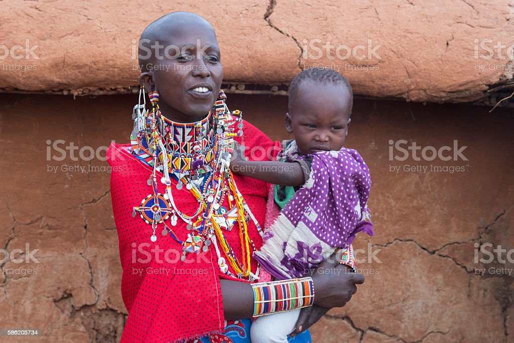Mother and daughter in Maasai village, Kenya, East Africa. stock photo