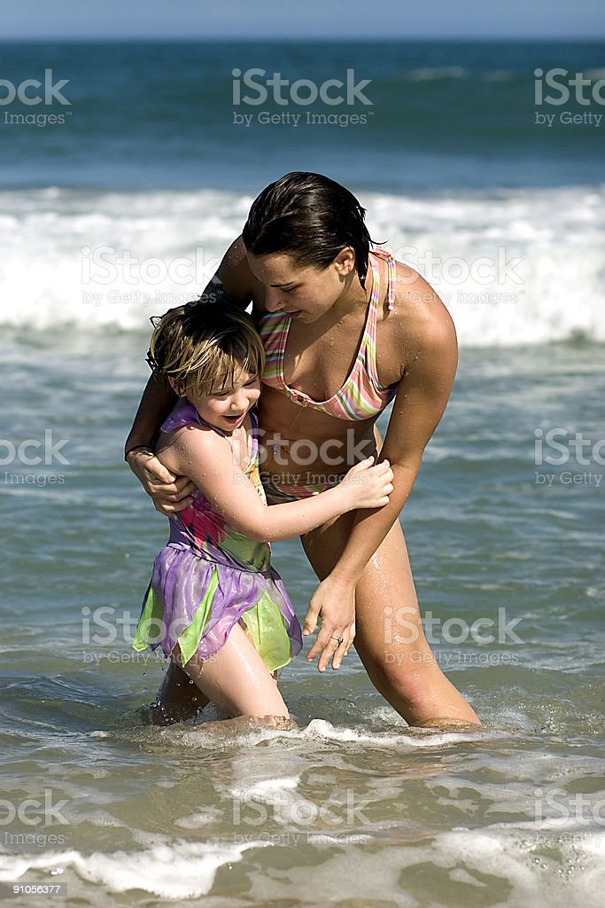 Mother and Daughter in Ocean Surf royalty-free stock photo