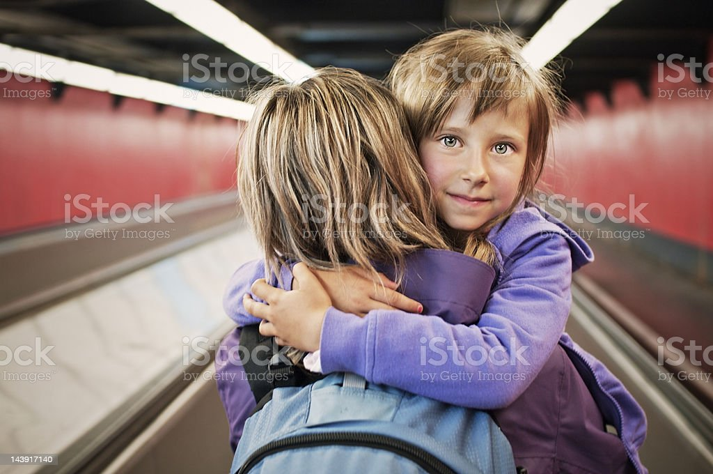 Mother and daughter in Paris metro moving walkway royalty-free stock photo