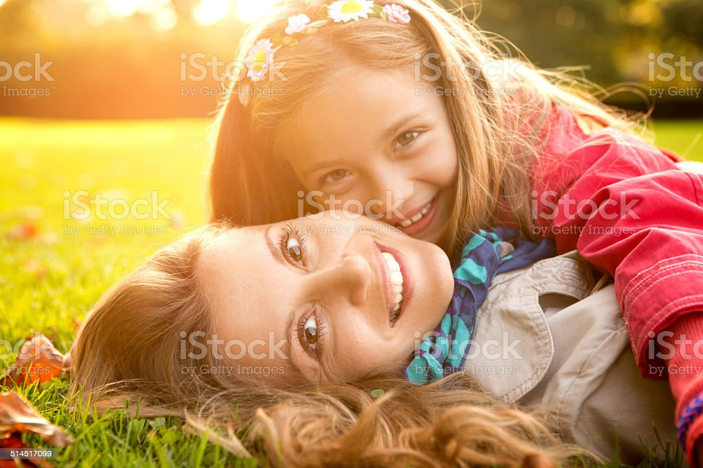 Mother and daughter in park. stock photo