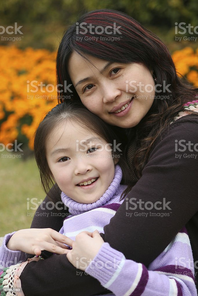 mother and daughter in park royalty-free stock photo