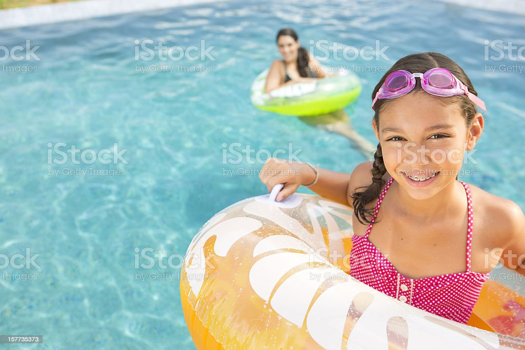 Mother and Daughter in Pool stock photo