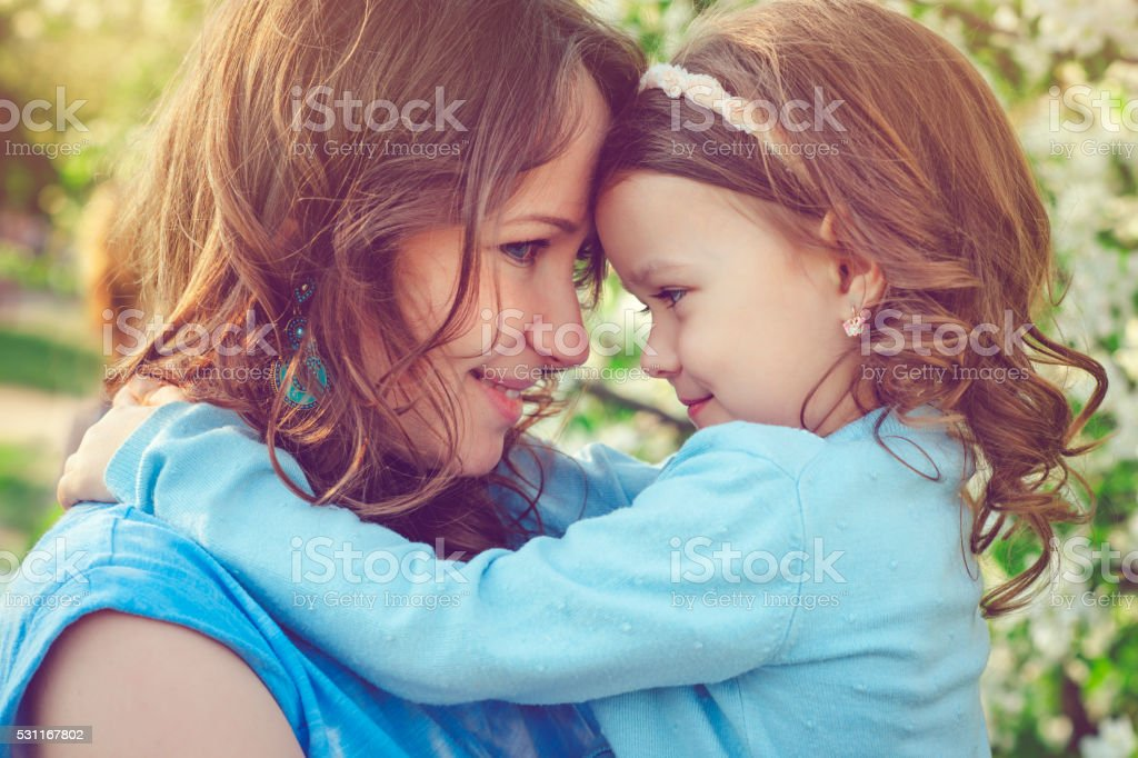 Mother and daughter in spring stock photo