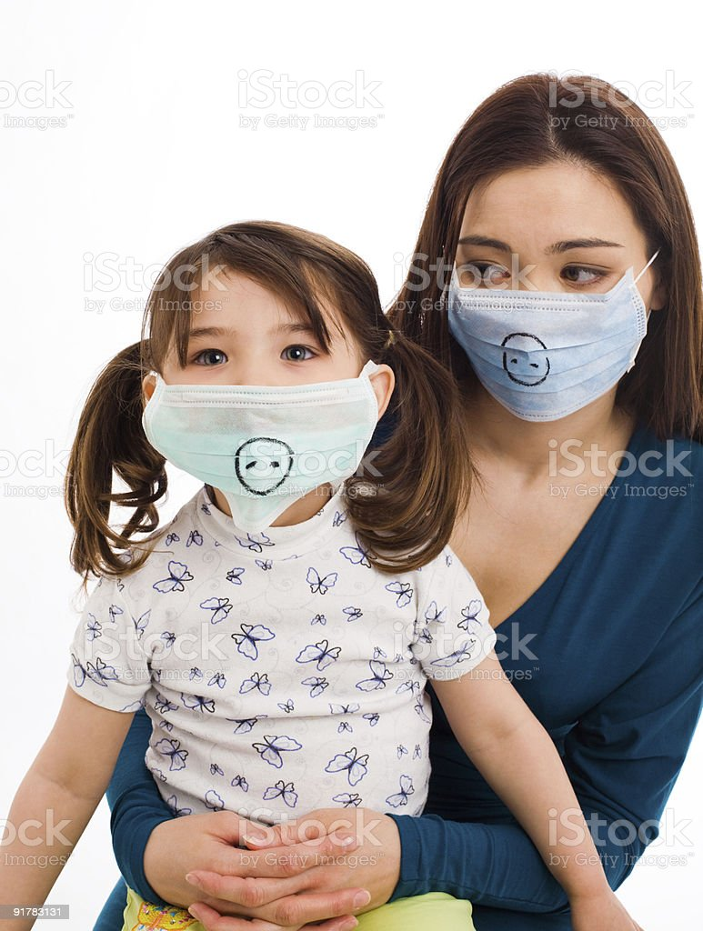 Mother and daughter in surgeon's masks royalty-free stock photo