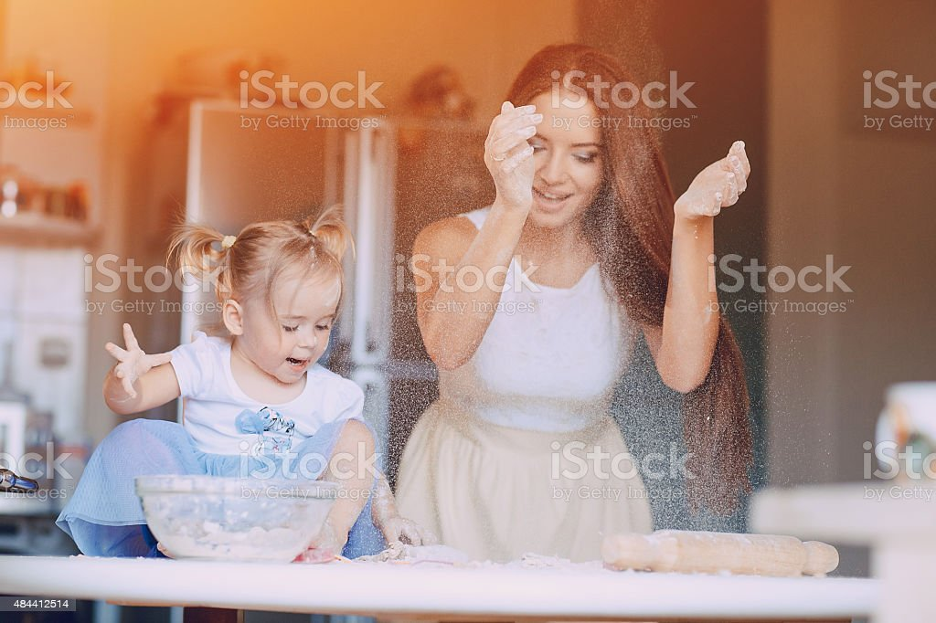 mother and daughter in the kitchen stock photo