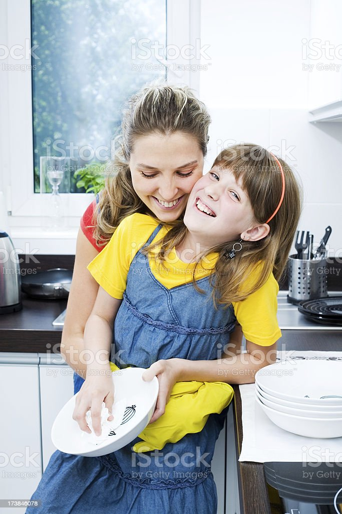 Mother And Daughter In The Kitchen Together royalty-free stock photo