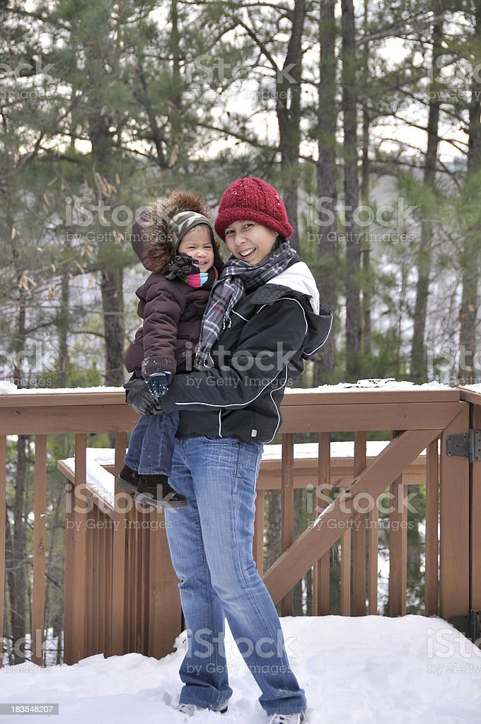 mother and daughter in the snow royalty-free stock photo