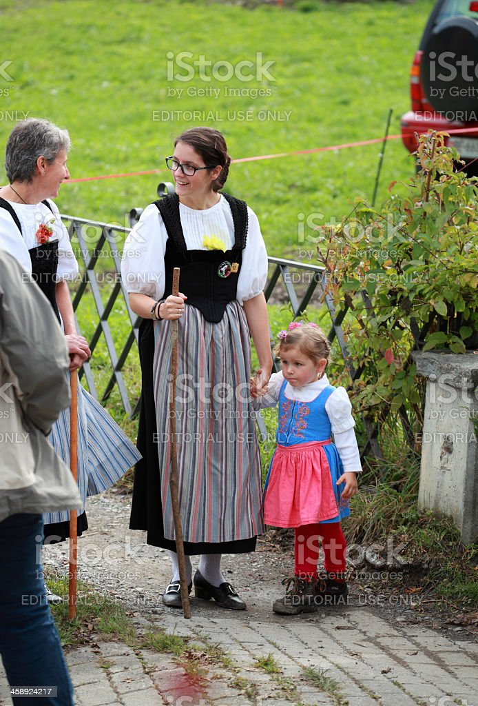 mother and daughter in traditional swiss costume stock photo