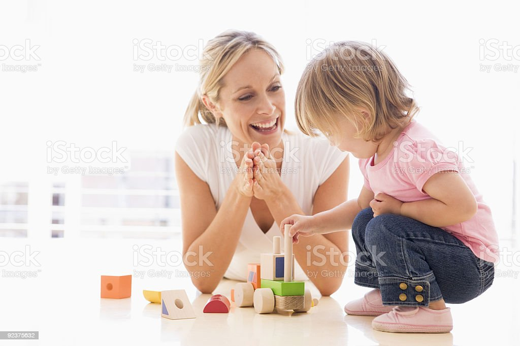 Mother and daughter indoors stock photo