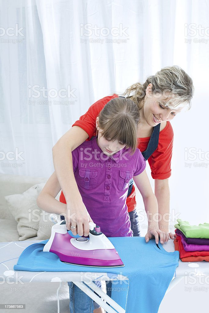 Mother And Daughter Ironing Together royalty-free stock photo