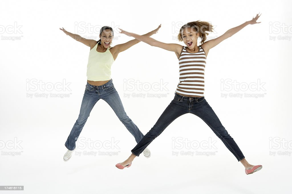 Mother And Daughter Jumping In Air stock photo
