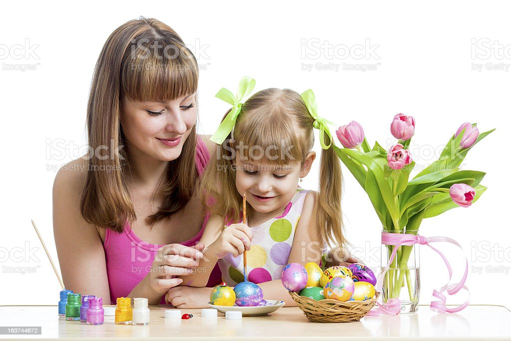 mother and daughter kid painting easter eggs isolated royalty-free stock photo