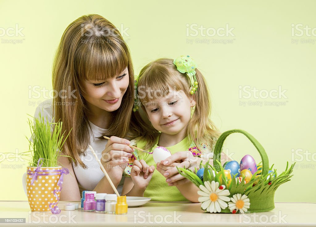 mother and daughter kid painting easter eggs royalty-free stock photo