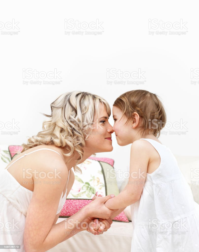 Mother and Daughter Kissing on the Nose royalty-free stock photo