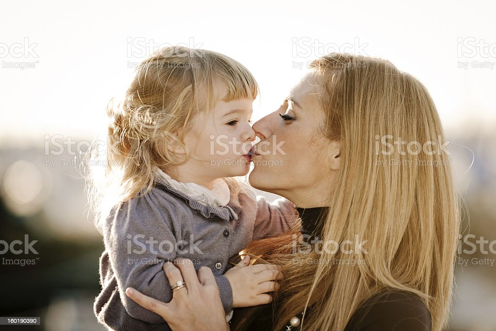 Mother and daughter kissing royalty-free stock photo