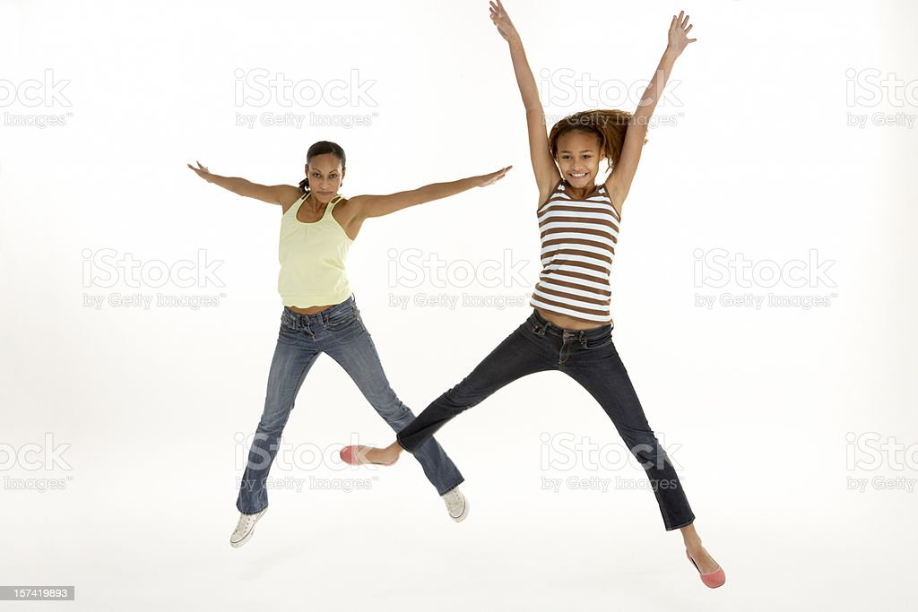 Mother And Daughter Leaping In Air stock photo
