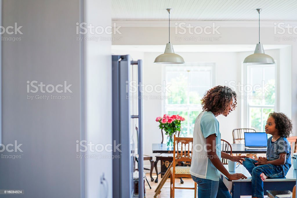 Mother and daughter looking at each other stock photo