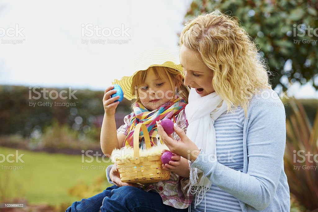 Mother and daughter looking at Easter eggs royalty-free stock photo