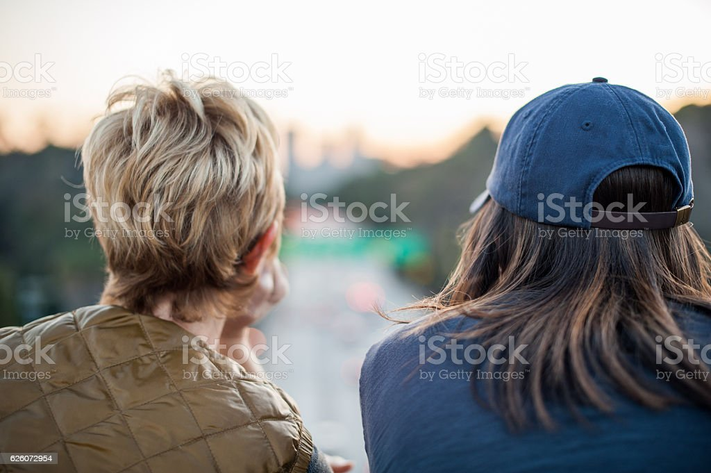 Mother and Daughter Looking at LA Skyline stock photo