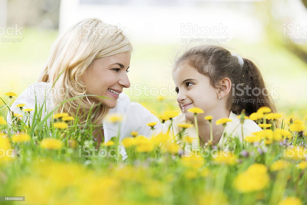 Mother and daughter lying in the park. royalty-free stock photo