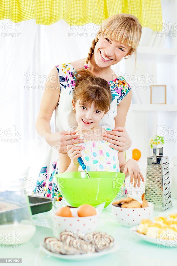 Mother and daughter making cookies royalty-free stock photo