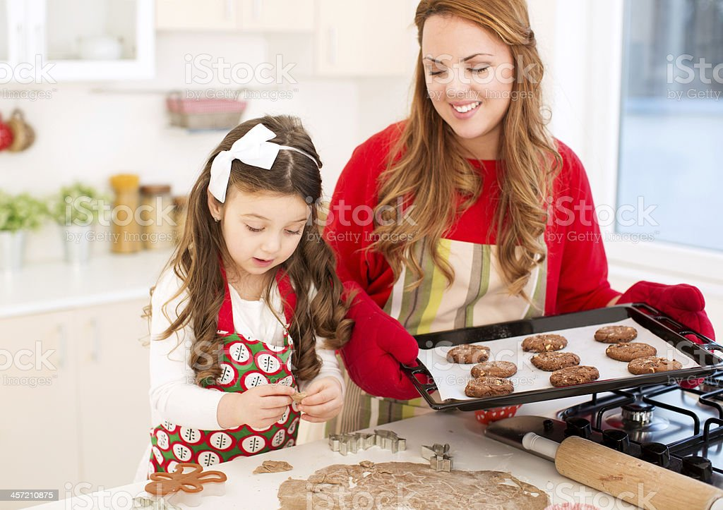Mother and daughter making cookies. stock photo