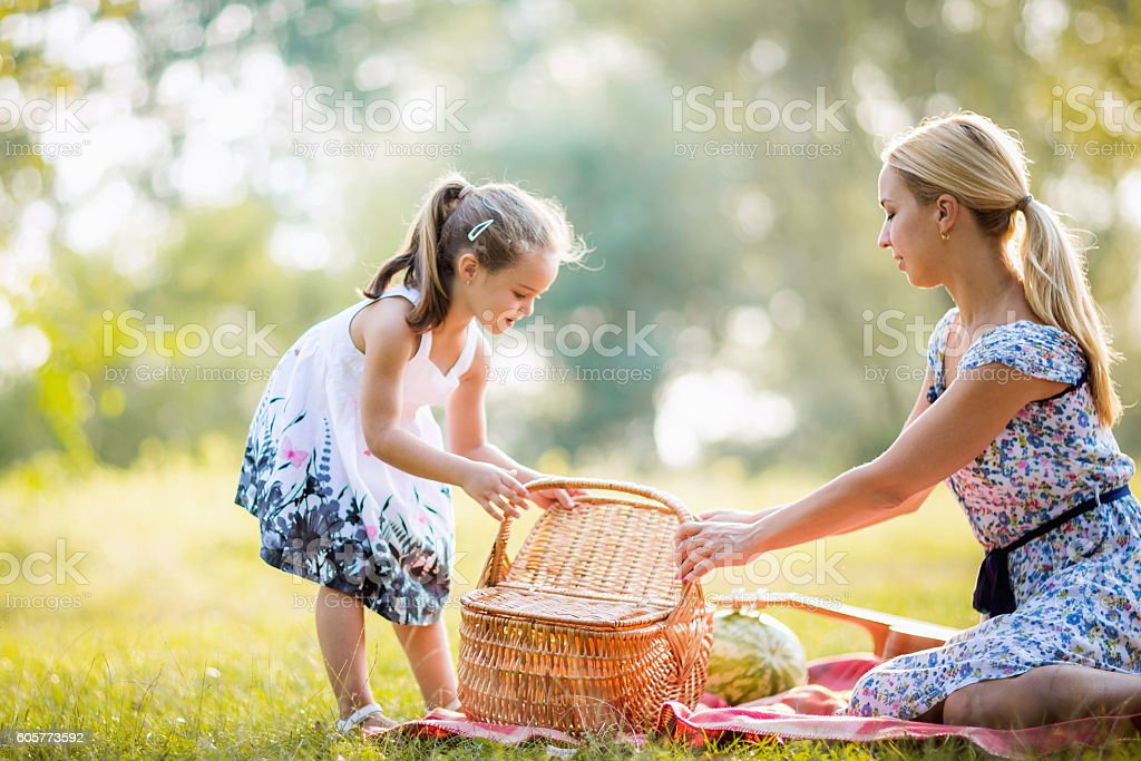Mother and daughter moments together on picnic stock photo