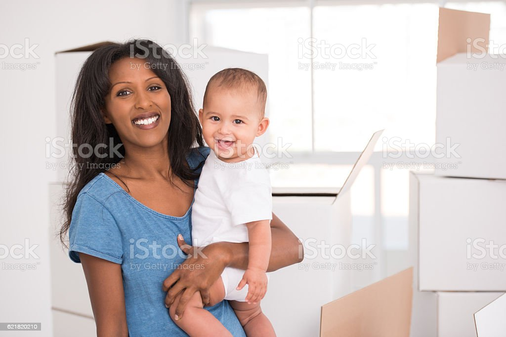 Mother and daughter moving home. stock photo