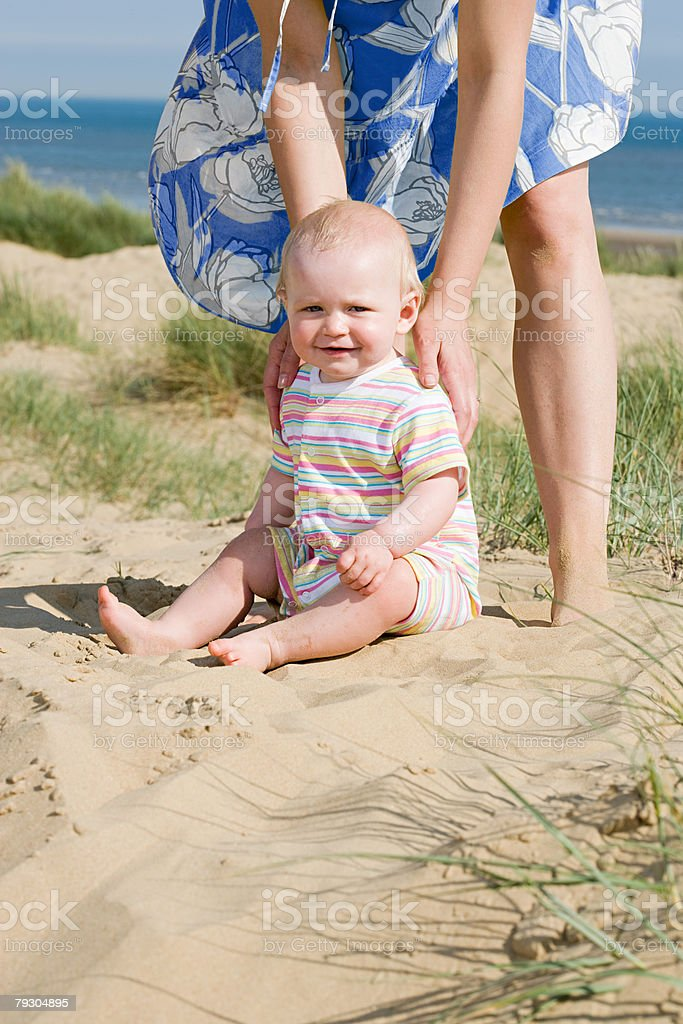Mother and daughter on a beach stock photo