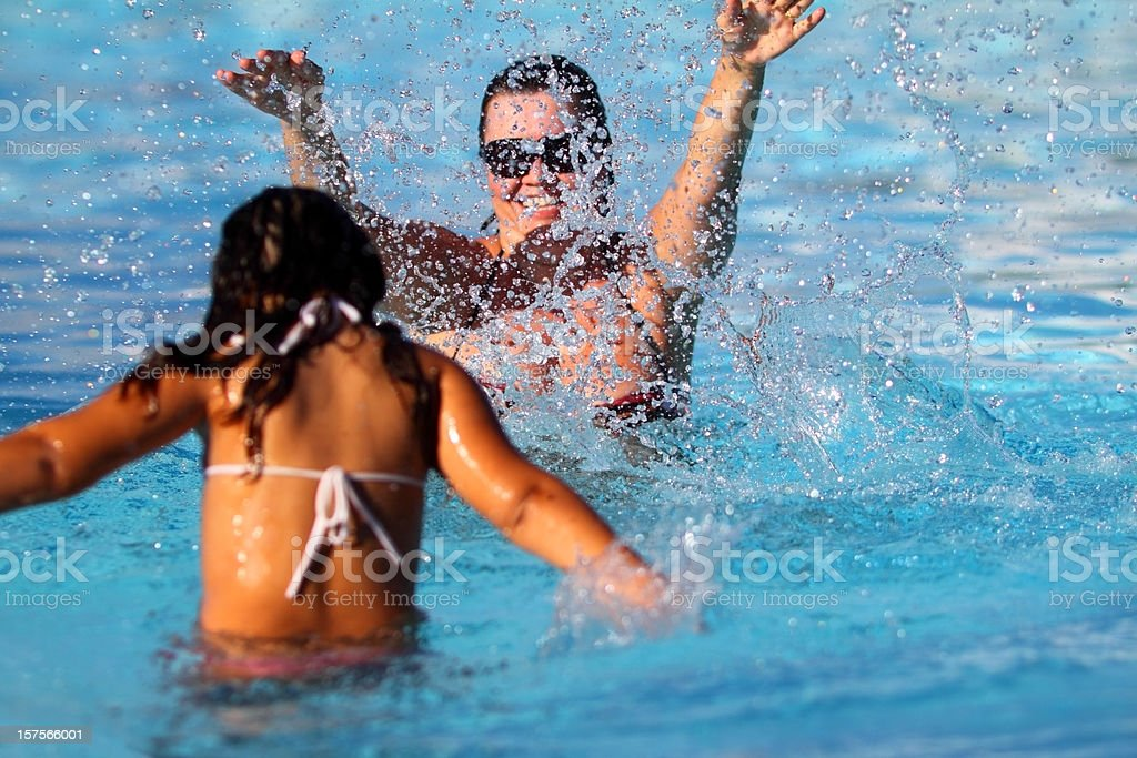 Mother and daughter  on a swimming pool royalty-free stock photo