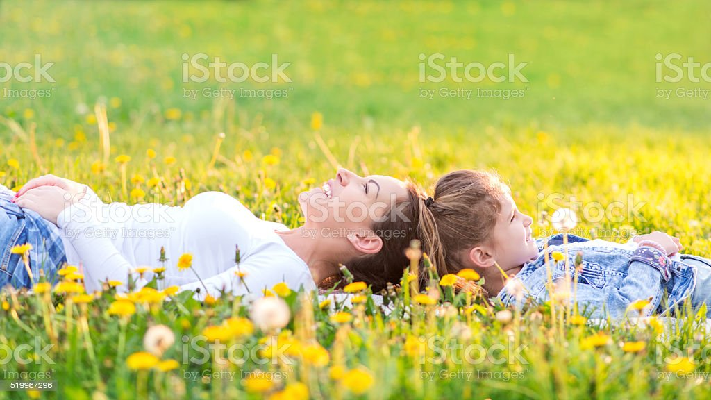 Mother and daughter on beautiful spring day stock photo