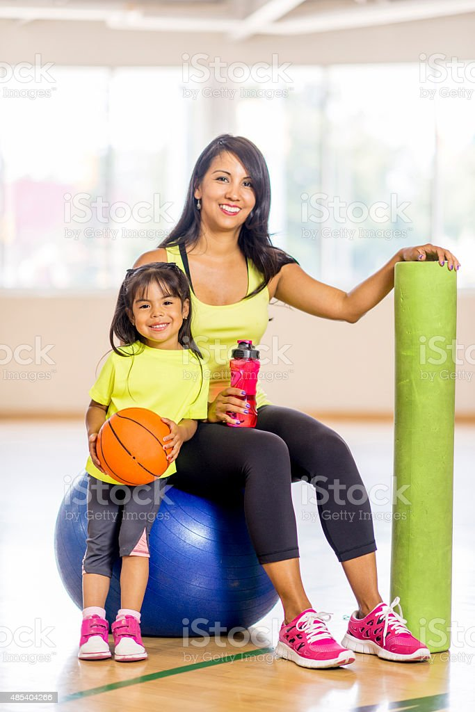 Mother and Daughter on Bosu Ball stock photo