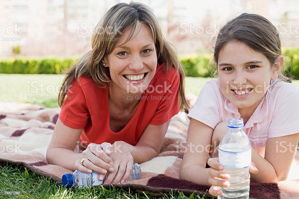 Mother and daughter on picnic blanket royalty-free stock photo
