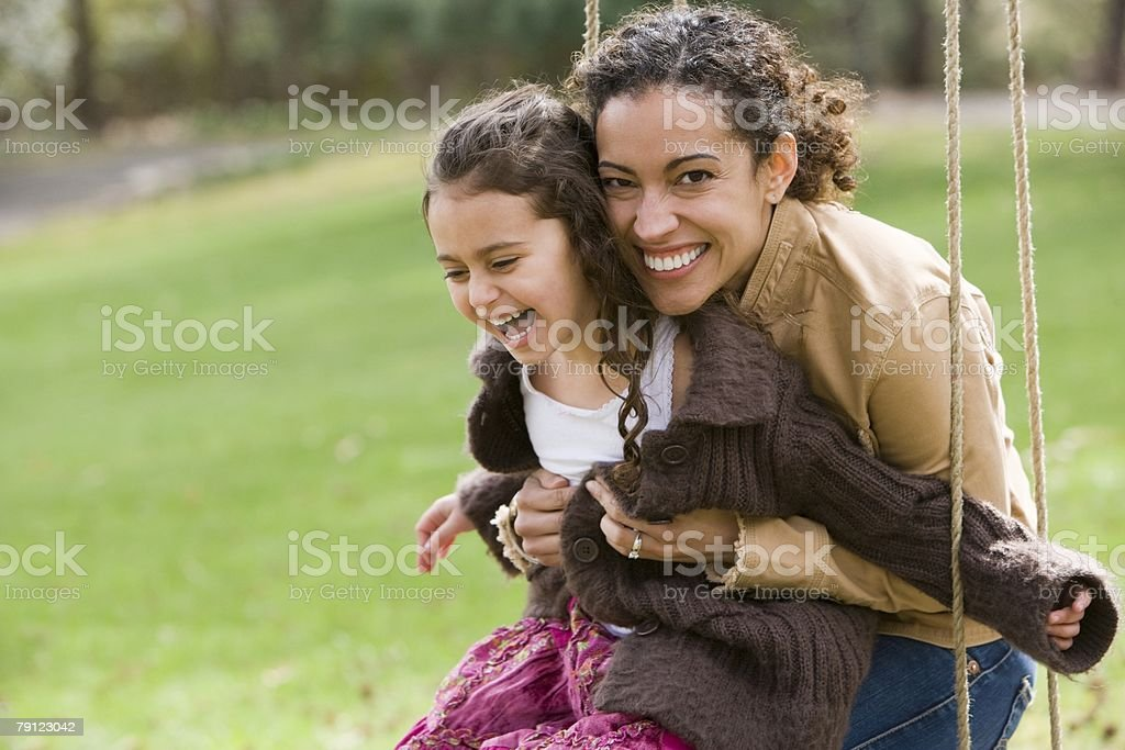 Mother and daughter on swing stock photo