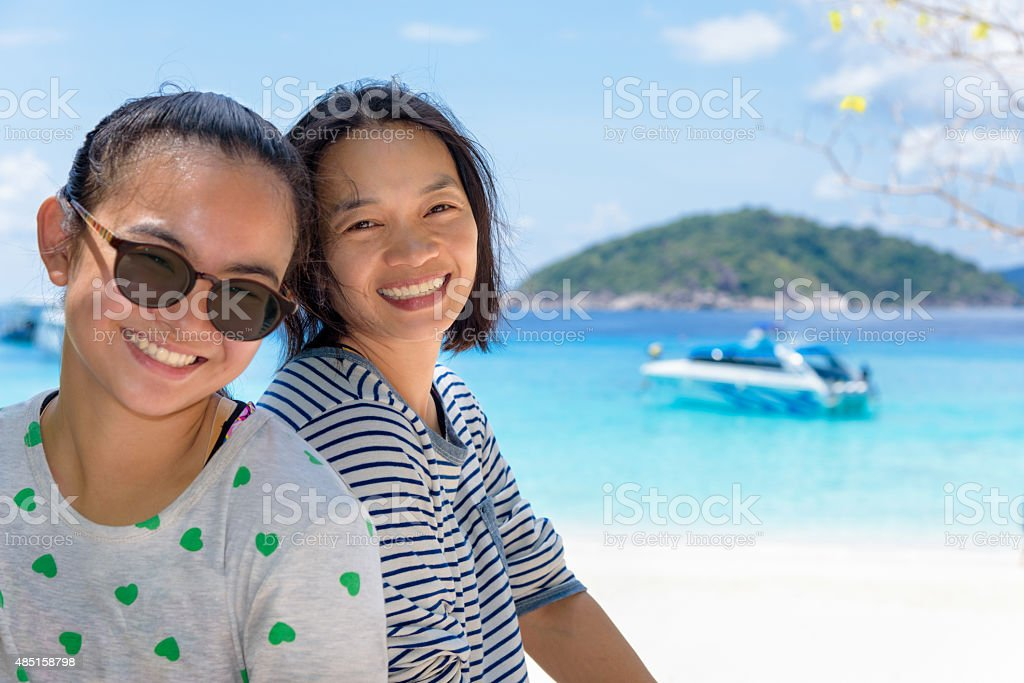 Mother and daughter on the beach at Similan islands, Thailand stock photo