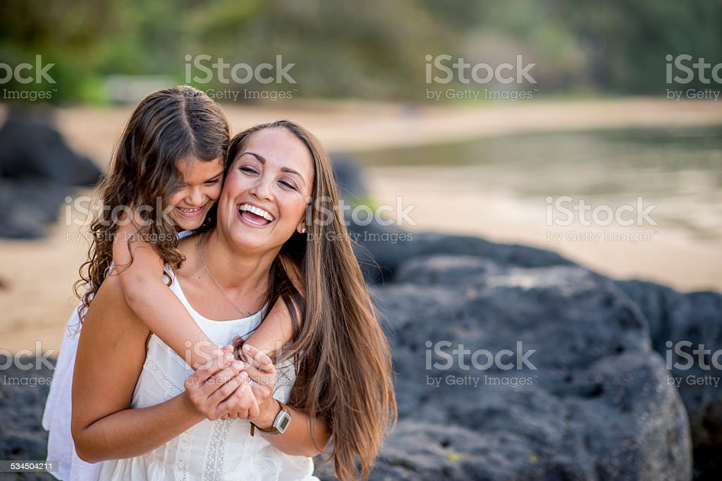 Mother and Daughter on the Beach in Hawaii stock photo
