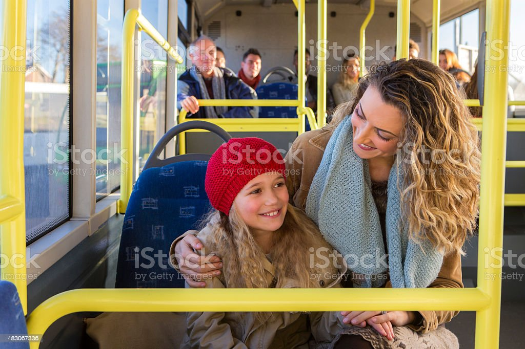Mother and daughter on the bus stock photo