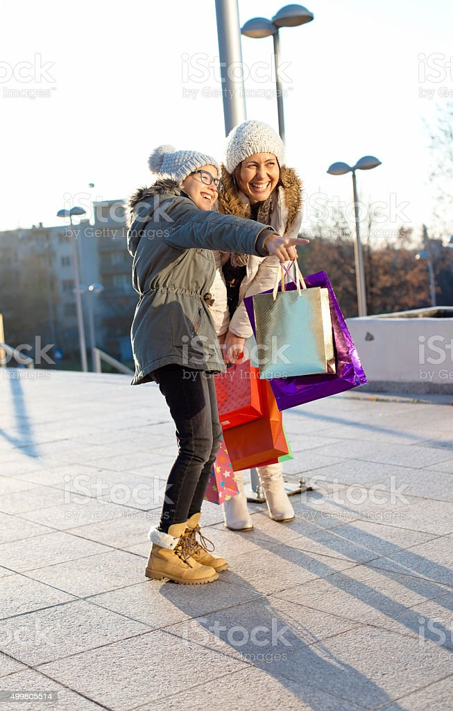 Mother and daughter  on the shopping center stock photo