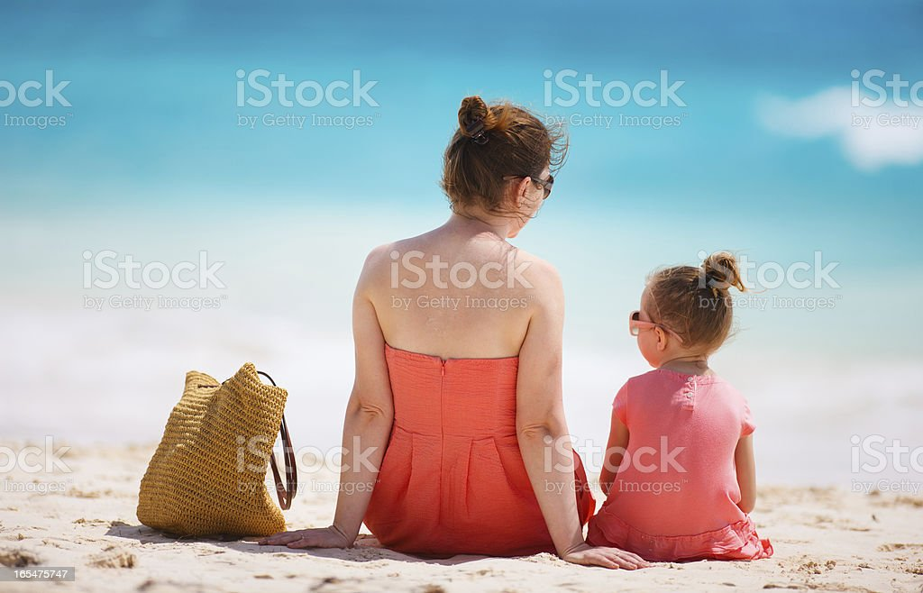 Mother and daughter on tropical beach royalty-free stock photo