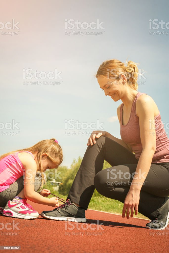 Mother and daughter outdoors. stock photo