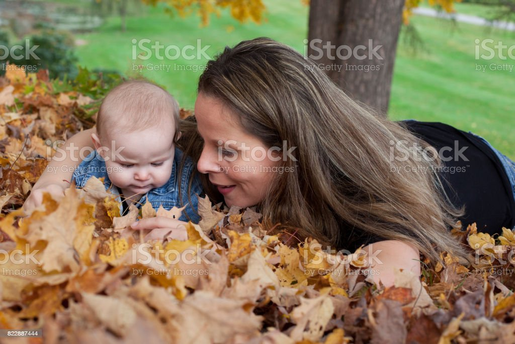 mother and daughter outside together stock photo