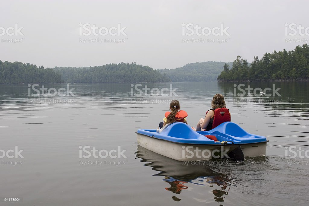 Mother and Daughter Paddleboating stock photo