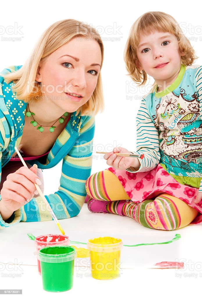 Mother and daughter painting together stock photo
