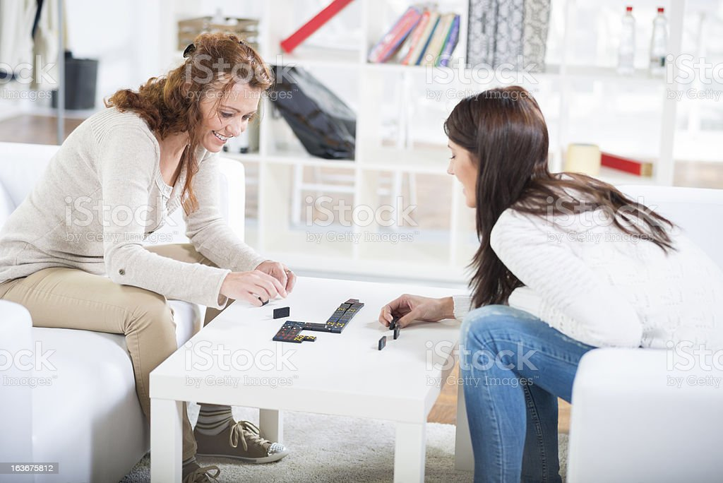 Mother and Daughter Playing Dominos royalty-free stock photo